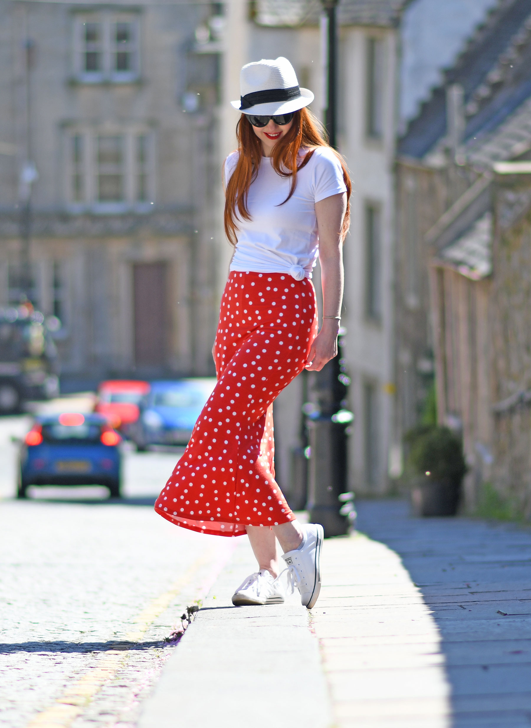 red polka dot midi skirt with white t-shirt and Converse sneakers